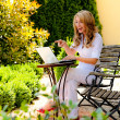Stock Photo: Woman with laptop in the garden