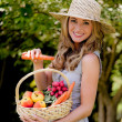 Stock Photo: Fruits and vegetables in the basket with his wife