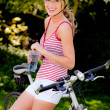 Stock Photo: Womwith mountain bike