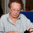 Pensioner counts their money from the pension — Stock Photo