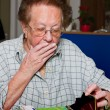 Stock Photo: Pensioner counts their money from the pension