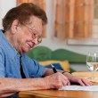 Senior signs a contract - Stock Photo