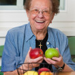 Senior woman with fruit for vitamins — Stock Photo