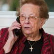 Senior woman with mobile phone leads phone conversation — Stock Photo #8268191