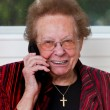 Senior woman with mobile phone leads phone conversation — Stock Photo #8268201