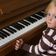 Child performs on a piano — Stock Photo #8269271