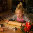Child at christmas in advent when baking cookies — Stockfoto