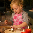 Child at christmas in advent when baking cookies — Stock Photo #8269314