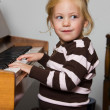 Child with piano — Stock Photo
