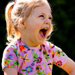 Stock Photo: Child laughs out loud and hearty
