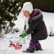 Shoveling snow in winter with snow shovel — Stock Photo