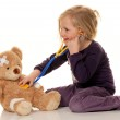 Child with a stethoscope as a medical doctor. pediatrician exami — Stock Photo