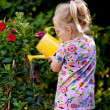 Child with watering can — Stock Photo #8269831