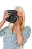 Young girls with a digital camera — Stock Photo