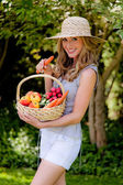 Fruits and vegetables in the basket with his wife — Stock Photo