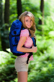 Woman in the woods while hiking — Stock Photo