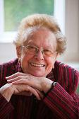 Friendly smiling elderly woman positive — Stock Photo