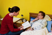 Sick elderly woman is visited — Stock Photo