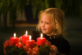 Child with advent wreath for christmas — Stock Photo