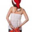 Stock Photo: Pretty young woman with christmas package