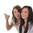 Two young women burst into laughter — Stock Photo