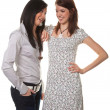 Stock Photo: Two young women whispering to each other