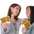 Two young girls playing cards — Stock Photo
