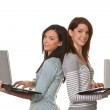 Young successful smiling women with laptop computer — Stock Photo