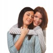 Two girlfriends in a tender embrace — Stock Photo