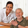 Nurse in elderly care for the elderly in nursing homes — Stock Photo