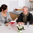 Stock Photo: Elderly woman reads from a book.