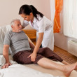 Stock Photo: Nurse in elderly care