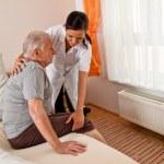 Nurse in elderly care — Stock Photo