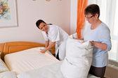 Nurse in elderly care for the elderly in nursing homes — Stock Photo