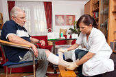 Wound care by nurses — Stock Photo