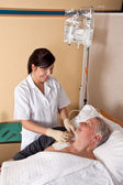Nurse gives a patient an infusion — Stock Photo