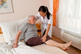 Nurse in elderly care for the elderly in nursing homes — Stok fotoğraf