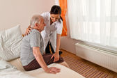 Nurse in elderly care — Stock Photo
