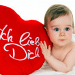 Small child with a baby cushion i love you — Stock Photo #8282484