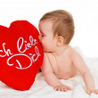 Small child with a baby cushion i love you — Stock Photo #8282495