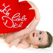 Small child with a baby cushion i love you — Stock Photo