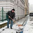 Caretaker admits sidewalk of snow — Stock Photo