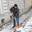 Stock Photo: Caretaker admits sidewalk of snow