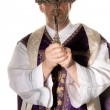 Catholic priest with a cross in worship — Stock Photo