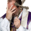 Stock Photo: Catholic priest with handcuffs. abuse.