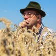 Thoughtful farmer in a corn field — Stock Photo #8282850