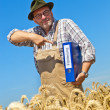 """Farmer with portfolio """"promotion"""" on cereal box — Stock Photo #8282869"""