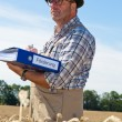 """Farmer with portfolio """"promotion"""" on cereal box — Stock Photo #8282871"""