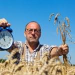 Farmer with clock 11:55 — Stock Photo #8282876