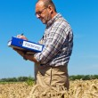 """Farmer with portfolio """"promotion"""" on cereal box — Stock Photo #8282878"""